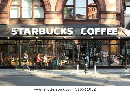 NEW YORK CITY - MAY 8, 2015: Starbucks store. Starbucks is the largest coffeehouse company in the world. - stock photo
