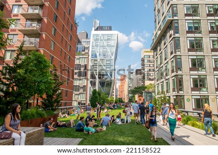 NEW YORK CITY - MAY 24, 2013: The High Line Park in Manhattan. The High Line is a popular linear park built on the elevated train tracks above Tenth Ave in New York City - stock photo