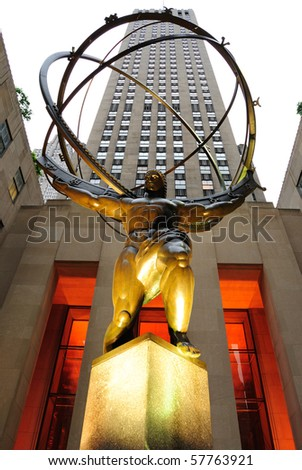 NEW YORK CITY - MAY 14: The historic Atlas Statue in Rockefeller Center stands in front o f the GE Building May 14, 2010 in New York City. - stock photo
