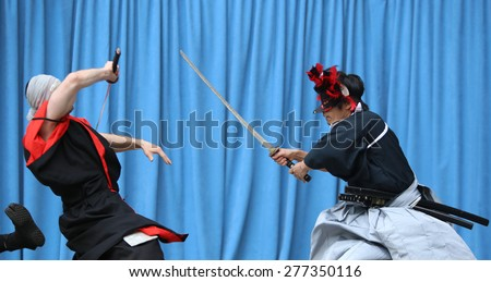 NEW YORK CITY - MAY 10 2015: the ninth annual Japan Day was celebrated in Central Park with displays of swordsmanship, folk-dance, music, Japanese food, calligraphy & kabuki face-painting - stock photo