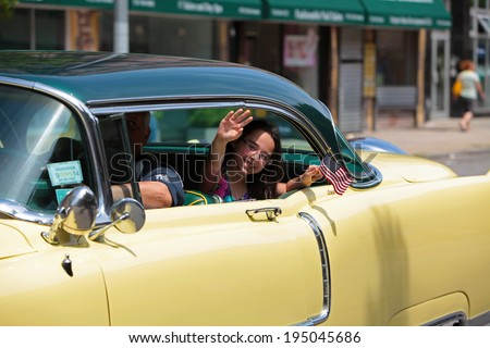 NEW YORK CITY - MAY 26 2014: The 146th annual King's County Memorial Day Parade, one of the nation's oldest, honored fallen & living veterans in the streets of Bay Ridge, Brooklyn. Vintage Plymouth - stock photo
