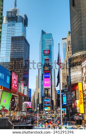 NEW YORK CITY - MAY 12: Times Square on May 12, 2013 in New York City. It's the brightly illuminated hub of the Broadway Theater District, one of the world's busiest pedestrian intersections. - stock photo