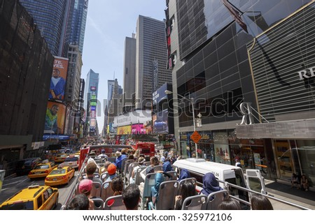NEW YORK CITY - MAY 27: Times Square with tourists in bus, featured with Broadway Theaters and animated LED signs, is a symbol of New York City and the United States, May 27, 2015 in Manhattan, NY - stock photo