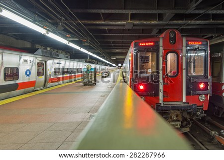 NEW YORK CITY - MAY 6, 2015: Train at platform inside Grand Central Station. The terminal is the largest train station in the world by number of platforms having 44. - stock photo