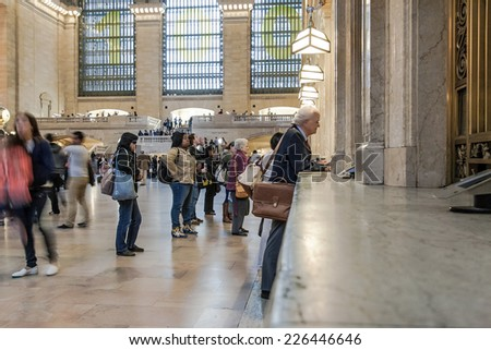 NEW YORK CITY- MAY 7 : view of commuters and tourists flood the grand central station during the afternoon rush hour. Tickets at Central Terminal in New York City, USA, May 7, 2013. - stock photo