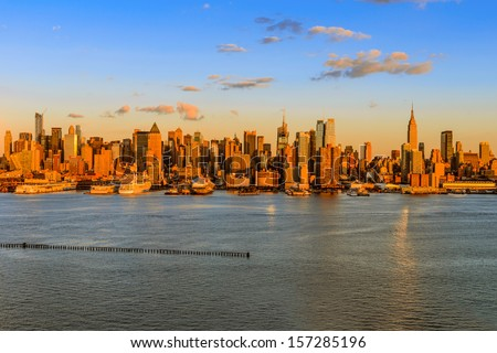New York City midtown skyline at sunset over Hudson river - stock photo