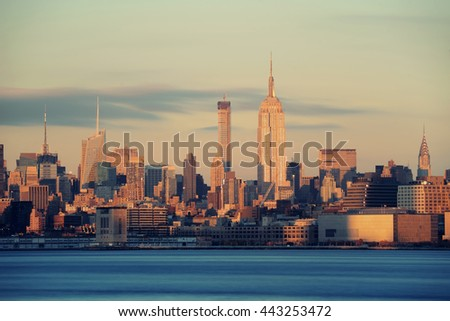 New York City midtown skyline with skyscrapers over Hudson River viewed from New Jersey - stock photo