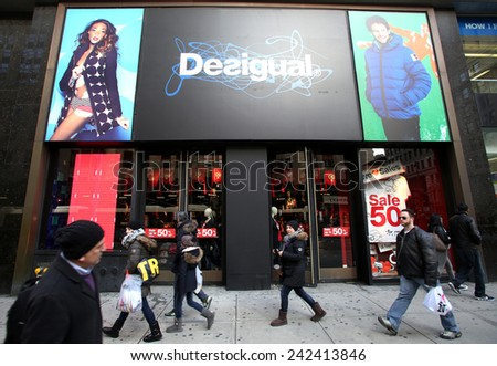 NEW YORK CITY - MONDAY, DEC. 29, 2014: Pedestrians walk past a Desigual clothing store. Desigual is a casual clothing brand based in Barcelona, Spain - stock photo