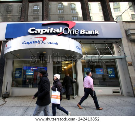 NEW YORK CITY - MONDAY, DEC. 29, 2014: People walk past a Capital One Bank branch.  Capital One Financial Corporation is a U.S.-based bank holding company. - stock photo