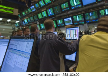 New York City, New York - April 16, 2007: Wall Street Stock Brokers Trading - stock photo