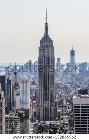New York City, New York - September 4: Empire State Building with its surrounding, in New York City, NY, on September 4, 2013. The Empire State Building stood as the tallest in the world for 40 years. - stock photo