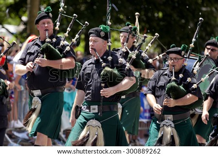New York City, New York, USA - July 10, 2015: NYC Sanitation Department Bagpipe Band performing during ticker-tape parade for the US Women National Soccer Team in New York City, NY on July 10, 2015 - stock photo