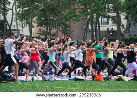 New York City, New York, USA; 09 July 2015: People participating in the free public Yoga class on Thursday evenings in summer at Bryant Park, New York City.