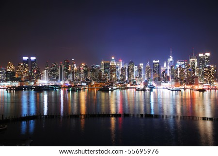 New York City night panorama with Manhattan Skyline over Hudson River with reflection.
