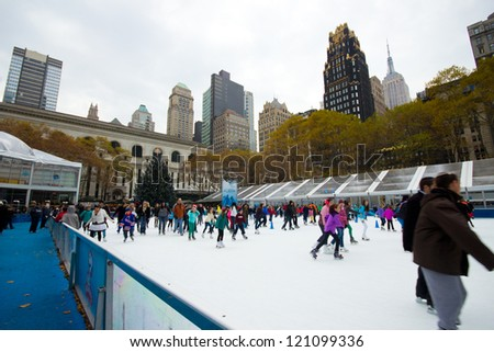 NEW YORK CITY - NOV 30: Bryant Park in New York City on Nov 30, 2012.  This  9.603 acre park located behind the NY Public Library features ice skating at Citi Pond and holiday boutiques. - stock photo