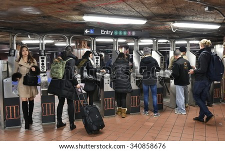 NEW YORK CITY - NOV 17: Commuters pass through a ticket barrier at 42nd Street Station on Nov 17, 2015 in New York City, USA. The subway station connects to Grand Central, the main railway hub of NYC. - stock photo