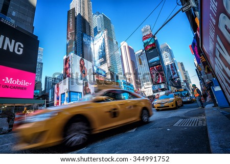 NEW YORK CITY - Nov 17: Times Square ,is a busy tourist intersection of neon art and commerce and is an iconic street of New York City and America, November 17th, 2015 in Manhattan, New York City. - stock photo