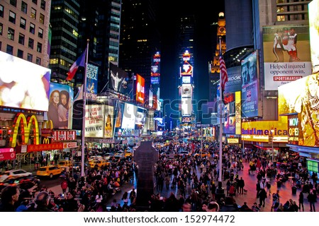 NEW YORK CITY - NOV 13: Times Square is a busy tourist intersection of neon art and commerce and is an iconic street of New York City and America, November 13th, 2011 in Manhattan, New York City. - stock photo