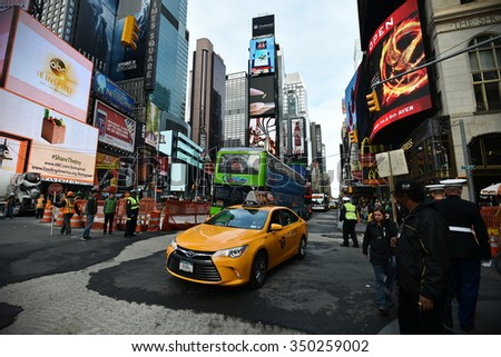 NEW YORK CITY - NOV 11: Traffic and people make their through Time Square in Manhattan on Nov 11, 2015 in New York City, USA.