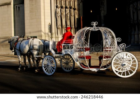 New York City - November 25, 2006:  A cinderella-inspired wedding coach with livery driver in red robe awaiting the bride and groom in front of Riverside Church - stock photo