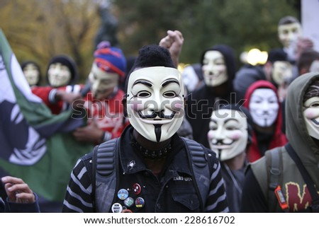NEW YORK CITY - NOVEMBER 5 2014: Anonymous & Stop Mass Incarcerations Network held a Million Mask March & Rally that started in Union Square & marched to Columbus Circle by way of Times Square - stock photo