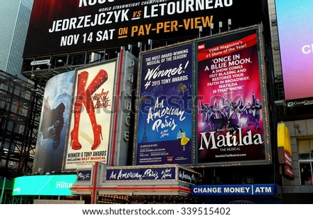 New York City - November 15, 2015:  Billboards advertising hit Broadway musicals Kinky Boots, An American in Paris, and Matilda in Times Square *