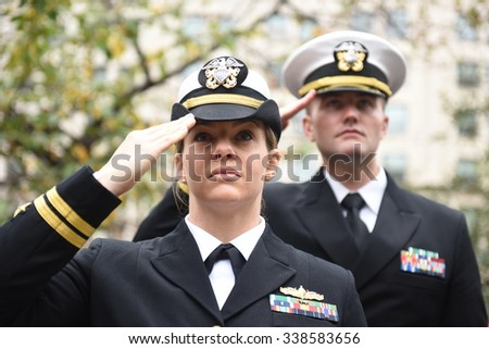 NEW YORK CITY - NOVEMBER 11 2015: New York City's Veterans Day parade was led by the US navy as this year's featured service. US navy in dress uniform salute during rendition of Star Spangled Banner - stock photo