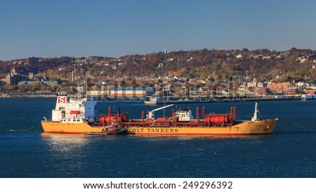 NEW YORK CITY, NOVEMBER 18:  Stolt Tankers chemical carrier Stolt Sapphire on November 18th, 2014 anchored on the Hudson River.  Stolt Tankers operate more than 150 chemical and bulk liquids ships. - stock photo