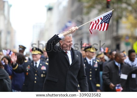 NEW YORK CITY - NOVEMBER 11 2015: the city's annual Veteran's Day parade was led by the US navy & grand marshal & navy veteran Robert Morgenthau. Mayor de Blasio marches with US flag