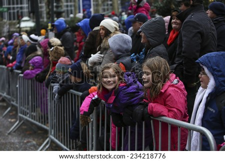 NEW YORK CITY - NOVEMBER 27 2014: the 88th annual Macy's Thanksgiving Day parade stretched from Manhattan's Upper West Side to Herald Square, viewed by 350,000 spectators. - stock photo