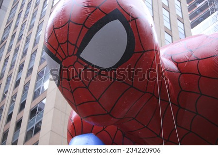 NEW YORK CITY - NOVEMBER 27 2014: the 88th annual Macy's Thanksgiving Day parade stretched from Manhattan's Upper West Side to Herald Square, viewed by 350,000 spectators. Spiderman - stock photo