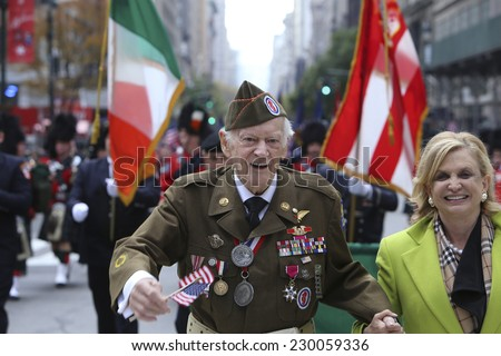 NEW YORK CITY - NOVEMBER 11 2014: the 95th annual Veteran's Day parade along Fifth Avenue is the largest Nov 11 celebration in the United States. US Representative Carolyn Maloney with WW ii vet - stock photo
