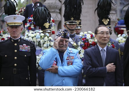NEW YORK CITY - NOVEMBER 11 2014: the 95th annual Veteran's Day parade along Fifth Avenue is the largest Nov 11 celebration in the United States. Wreath ceremony by Eternal Light Monument - stock photo