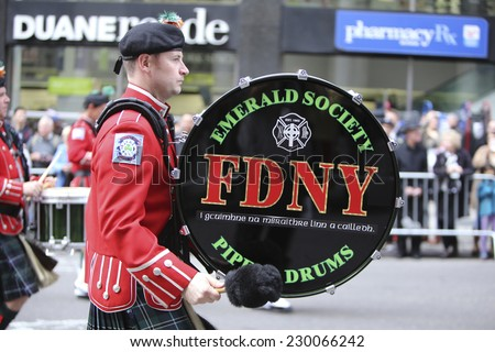 NEW YORK CITY - NOVEMBER 11 2014: the 95th annual Veteran's Day parade along Fifth Avenue is the largest Nov 11 celebration in the United States. Emerald Society drummer