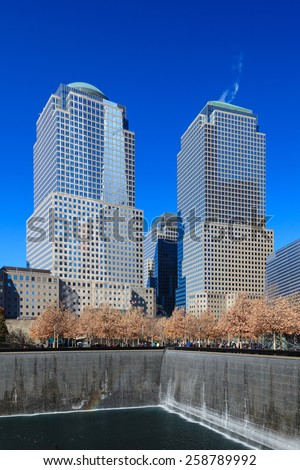 NEW YORK CITY, NOVEMBER 18:  The view across the 9/11 Memorial site to Two and Three World Financial Centers in New York City pictured on November 18th, 2014.  - stock photo