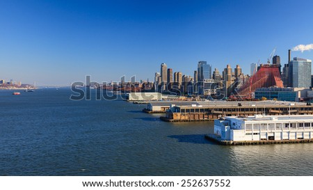 NEW YORK CITY, NOVEMBER 18:  The view up the Hudson River in New York City on November 18th, 2014.  The Upper Manhattan skyline can be seen with the George Washington Bridge in the far distance. - stock photo