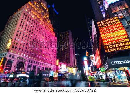 NEW YORK CITY - November 2015. Times Square crowds and traffic at night. - stock photo