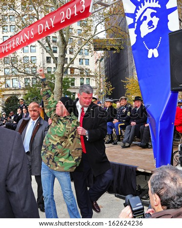 NEW YORK CITY - NOVEMBER 11 2013: Veterans' Day was marked by a ceremonial wreath laying at the Eternal Light Monument in Madison Square Park & parade on Fifth Avenue November 11 2013 in New York City