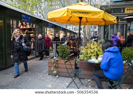 NEW YORK CITY- NOVEMBER 16, 2014:  View of holiday boutiques at historic Bryant Park in Midtown Manhattan with people in the scene