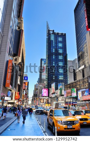 NEW YORK CITY, NY - AUG 12: 42nd Street with traffic and commercials on August 12, 2011 in New York City. 42nd Street is a major crosstown street known for its theaters and landmark architectures. - stock photo