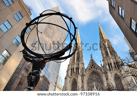 NEW YORK CITY, NY - DEC 30: Atlas statue and St. Patrick's Cathedral on December 30, 2011 in New York City. Fifth Avenue has the world's most expensive retail spaces as the symbol of wealthy New York. - stock photo