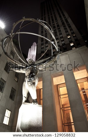NEW YORK CITY, NY - DEC 30: Atlas statue on Fifth Avenue on December 30, 2010 in New York City. The sculpture is 15 feet tall, the entire statue is 45 feet tall, by sculptor Lee Lawrie. - stock photo