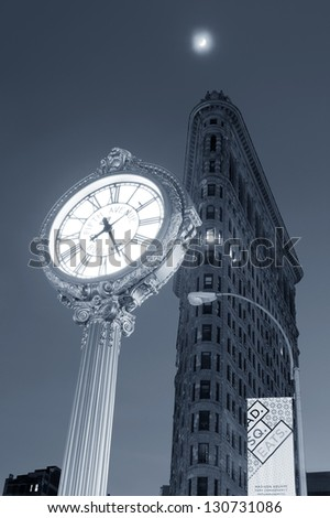 NEW YORK CITY, NY - DEC 30: Flatiron Building at night on March 30, 2011 in New York City. Flatiron building designed by Chicago's Daniel Burnham was designated a New York City landmark in 1966. - stock photo