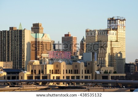 New York City, NY - June 7, 2016: The downtown Brooklyn skyline from the bridge with a view of the famous Watchtower sign on the rooftops