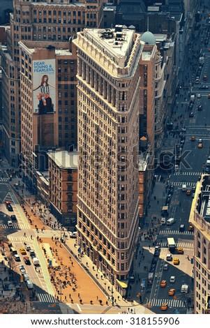 NEW YORK CITY, NY - MAR 30: Flatiron Building rooftop view on March 30, 2014 in New York City. Flatiron building designed by Chicago's Daniel Burnham was designated a New York City landmark in 1966. - stock photo