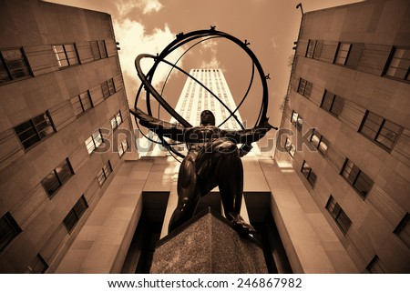 NEW YORK CITY, NY - MAR 30: Rockefeller Plaza Atlas statue on March 30, 2014 in New York City. Declared a National Historic Landmark in 1987, it is a complex of 19 commercial buildings - stock photo