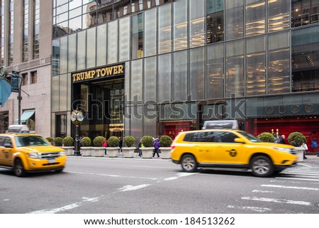 NEW YORK CITY, NY  - MARCH 14, 2014:  Fifth Avenue in midtown Manhattan with Trump Tower and Gucci in view.  Fifth Ave is ranked among the most expensive shopping streets in the world. - stock photo
