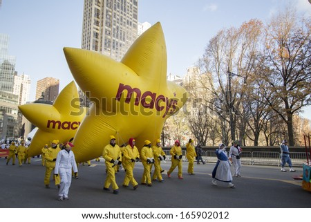 NEW YORK CITY, NY - NOVEMBER 28 : Large Yellow Macy's Stars going through W 59th ST during the Macy's 87th Annual Thanksgiving Day Parade on November 28, 2013 in New York City, New York.  - stock photo