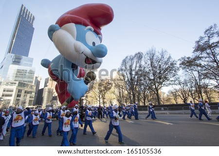 NEW YORK CITY, NY - NOVEMBER 28 : Papa Smurf Balloon on W 59th street during the Macy's 87th Annual Thanksgiving Day Parade on November 28, 2013 in New York City, New York.  - stock photo