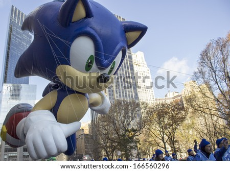 NEW YORK CITY, NY - NOVEMBER 28 : Sonic The Hedgehog balloon going through W 59th street during the Macy's 87th Annual Thanksgiving Day Parade on November 28, 2013 in New York City, New York.  - stock photo